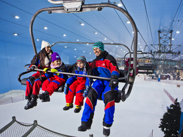 A family on the ski lift at Ski Dubai.